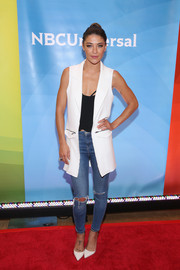 Jessica Szohr layered a sleek white vest over a low-cut black top for the NBC New York Summer Press Day.