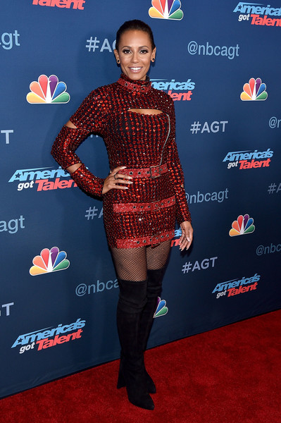 Melanie Brown kept it fierce all the way down to her black Stuart Weitzman over-the-knee boots.