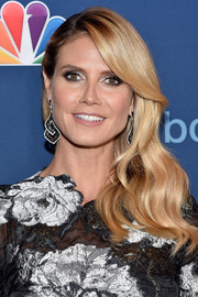 Heidi Klum made her eyes pop with a swipe of silver shadow.