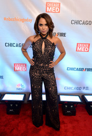 Monica Raymund looked foxy in a black lace halter jumpsuit at the premiere of 'Chicago Fire,' 'Chicago P.D.,' and 'Chicago Med.'