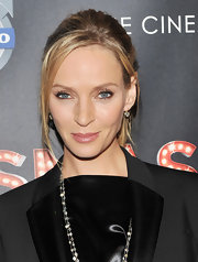 Uma Thurman wore her hair in a casual updo with long face-framing strands at the premiere of 'Smash.