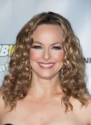 Melora Hardin showed off her glamorous red carpet look with these tight curls.