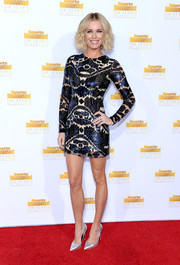 Rebecca Romijn was all dolled up in a sequined black mini dress at the Sports Illustrated Swimsuit Issue 50th anniversary bash.