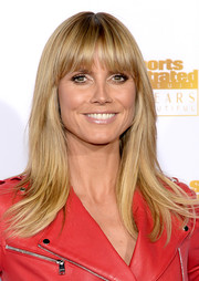 Heidi Klum looked youthful with her straight cut and wispy bangs at the Sports Illustrated Swimsuit Issue 50th anniversary bash.