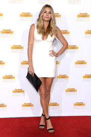 Tori Praver teamed her sultry dress with an elegant black crocodile clutch.