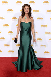 Kathy Ireland was all glammed up in a strapless green mermaid gown by Keepsake during the Sports Illustrated Swimsuit Issue 50th anniversary bash.