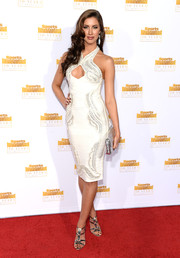 Katherine Webb oozed sex appeal at the Sports Illustrated Swimsuit Issue 50th anniversary bash in an embellished white dress with a cleavage-revealing cutout.