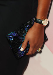 Mel B glamed things up with her gemstone encrusted clutch. A great way to add sparkle to a black dress.