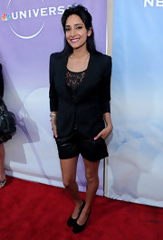 Rebecca Hazlewood accessorized with several silver bangle bracelets.  A nice touch with this all-black outfit.