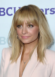 Nicole Richie attended the NBC Universal 2012 Winter TCA Press Tour All Star Party wearing her blond hair with long lash-grazing bangs.