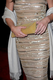 Jillian Michaels complemented her beaded dress with a glittery yellow envelope clutch at the Golden Globes after-party.