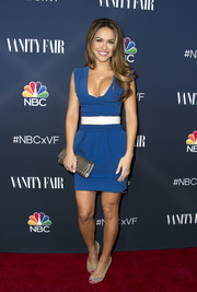 A metallic gold clutch sealed off Chrishell Stause's ensemble.
