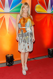 Kelli Giddish looked vibrant at the NBC Upfront presentation in this orange blousy dress.