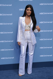 Kourtney Kardashian opted for seductive suiting with this sleek white Sergio Hudson jacket and pants ensemble teamed with a lacy bra during the NBCUniversal Upfront.