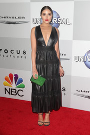 Olivia Culpo hovered between edgy and sweet in a deep-V black leather dress by Valentino at the NBCUniversal Golden Globes after-party.
