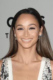 Cara Santana wore her hair loose and straight with a center part at the NBCUniversal Golden Globes after-party.