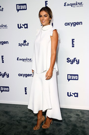 Serinda Swan attended the NBCUniversal Cable Entertainment Upfronts wearing a loose, high-neck white blouse.