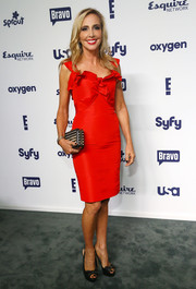 Shannon Beador contrasted her ladylike dress with an edgy studded clutch.