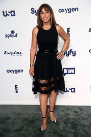Melissa Rivers paired her dress with modern silver PVC cap-toe pumps.