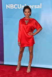 Melanie Brown donned a red mini dress with asymmetrical sleeves for the 2018 NBCUniversal Summer Press Day.