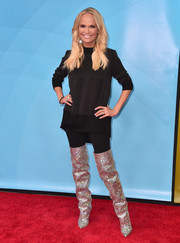 Kristin Chenoweth teamed a black mock-neck sweater with sparkly thigh-high boots for the 2018 NBCUniversal Summer Press Day.