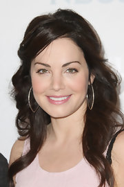 Erica Durance swept on a sheer pearly pink lipstick for NBCUniversal Summer Press Day.