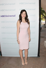 Erica Durance paired her pale pink sheath with shiny champagne-hued peep toe sandals.