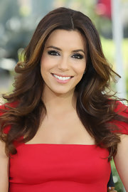Eva Longoria wore her hair in long feathered waves while attended NBCUniversal Summer Press Day.