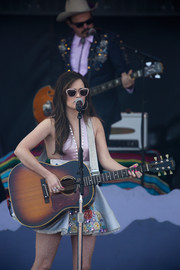 Kacey Musgraves coordinated her cute dress with a pair of glittery pink cateye sunnies for her performance at the NCAA March Madness Music Festival.