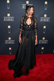 Ciara brought major sex appeal to the NFL Honors with this sheer black keyhole-cutout gown by Uel Camilo.