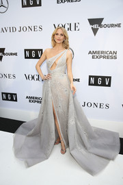 Poppy Delevingne finished off her glamorous look with silver ankle-strap sandals.