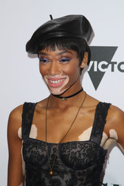 Winnie Harlow accessorized with a black leather beret by Dior for some Parisian flavor.