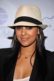 Tia Mowry paired her sleek blazer with a gold butterfly pendant neckalce.