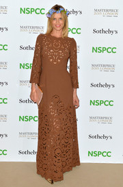 Eva Herzigova kept it demure in an embroidered brown dress during the NSPCC Neo-Romantic Art Gala.