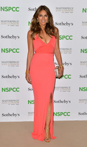 For the NSPCC Neo-Romantic Art Gala, Elizabeth Hurley donned a coral evening dress that displayed her bountiful assets to advantage.