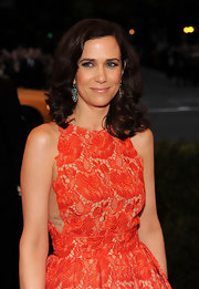 Kristen Wiig paired her colorful lacy dress with antique blue enamel and diamond pendant earrings.