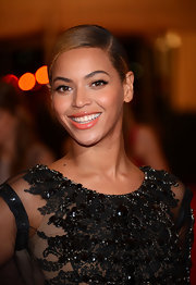Beyonce wore a glimmering muted coral lipstick for the Costume Institute Gala.