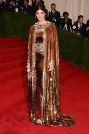 Bianca Brandolini D'adda went all out at the Met Gala dripping in a bronze sequined cape and gown.