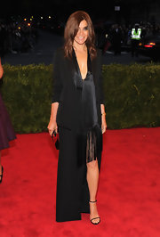 Carine Roitfeld looked almost barefoot in her black skinny-strap sandals.