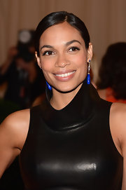 Rosario Dawson paired her luxe leather dress with art deco diamond lapis pendant earrings.