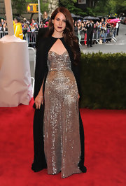 Lana Del Rey brought on the drama in this bead-saturated silver gown and black cape at the Met Gala.