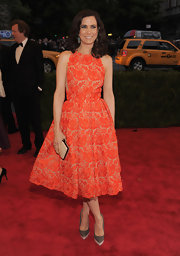 Kristen Wiig was a total doll in this orange lace embroidered frock at the Met Gala.