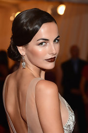 Camilla Belle swept her hair back into a low voluminous bun for the Costume Institute Gala.