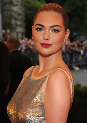Kate Upton added a punch of bright glossy red to her look for the Costume Institute Gala.