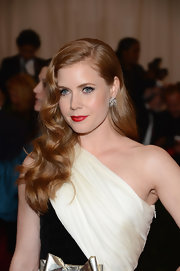Amy Adams wore her shining copper locks in flowing side-swept curls at the Costume Institute Gala.