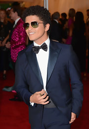 Bruno Mars looked ridiculously charming in his retro navy suit and bow tie at the Met Gala.