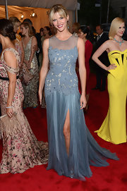 Brooklyn Decker looked perfectly dressed for spring in this airy sky blue chiffon gown with an embroidered bodice.