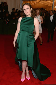 Lena Dunham jumped in on the high-low hem trend in this emerald dress on the Met Gala red carpet.