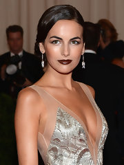 Camilla Belle swept on a rich chocolate brown lipstick with a glossy finish for the Met Gala.