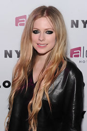 Avril applied a thick black liner and shadow above and below her lid for a super heavy smoky look.
